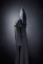 Scary figure in hooded cloak