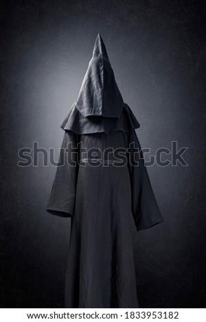 Scary figure in hooded cloak Zdjęcia stock ©