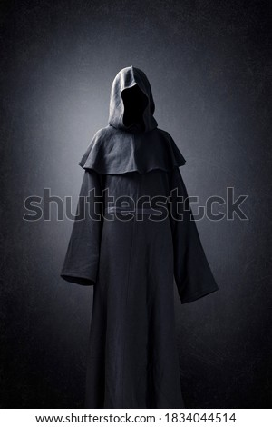 Scary figure in hooded cloak Stock photo ©