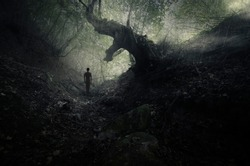 scary forest scene with old tree and mysterious ghostly figure, gothic landscape
