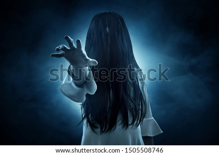 Photo of  Scary ghost on dark background