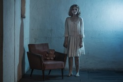 scary girl in white dress from horror film in  room