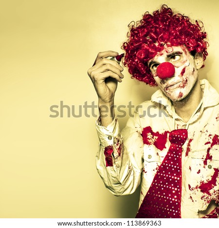 Scary Grunge Clown In Dirty Business Suit And Tie Drawing On The Walls With A Red Pen For You To Write Your Halloween Message In Blood