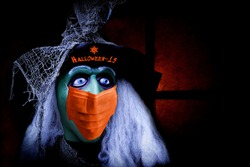 Scary Halloween Coronavirus COVID-19 Witch Wearing Protective Face Mask. Halloween concept.