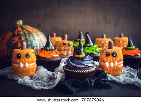 Scary Halloween cup cakes on the table,selective focus
