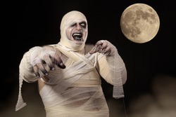 Scary Halloween Mummy in the mist. Young men in mummy costume