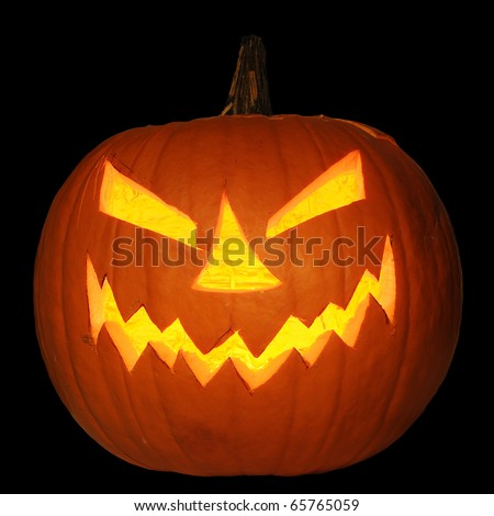 Scary halloween pumpkin jack-o-lantern candle lit, isolated on black background
