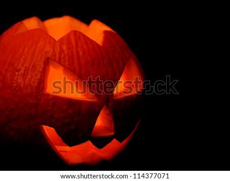 Scary halloween pumpkin jack-o-lantern on black background