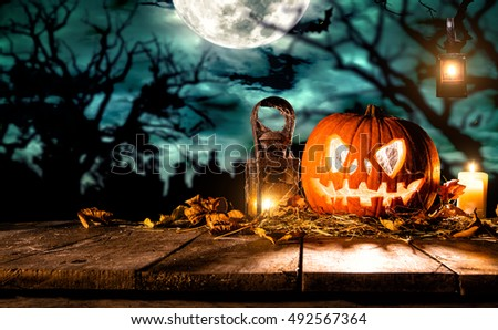 Scary halloween pumpkin on wooden planks. Empty space for text #492567364