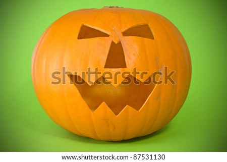 scary halloween pumpkin over a green background