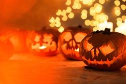 Scary Halloween pumpkins lanterns on the table