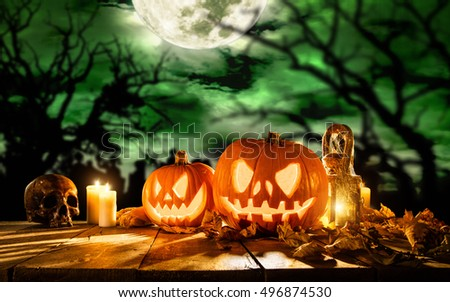 Scary halloween pumpkins on wooden planks. Empty space for text #496874530