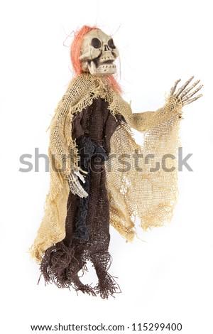 Scary Halloween skeleton figure on white