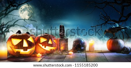 Scary horror background with halloween pumpkins jack o lantern, placed on wooden deck. Halloween spooky background. #1155185200