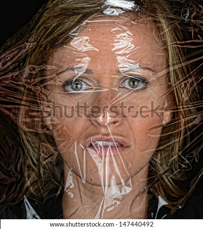 stock-photo-scary-image-of-a-woman-under-plastic-wrap-147440492.jpg