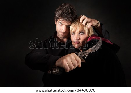 Scary man threatens witch with sharp athame knife