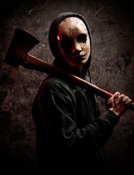 Scary Man with mask holding an axe