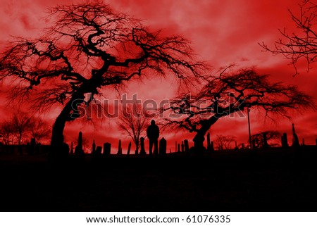 Scary pic of cemetery with hellfire sky and scary trees.  Perfect for Halloween or horror themes.