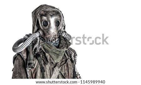 Scary post apocalyptic, living underground, creature with vintage lantern on shoulder, wearing rags and creepy full-face gas mask under tattered hood, studio shoot isolated on white with copy space