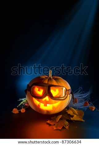 scary pumpkin flying glasses on a dark background