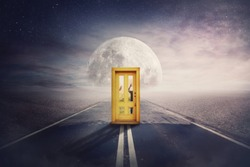 Scary scene with spirit silhouettes coming from another world, parallel universe, try to open a door in the middle of a road. Spooky hands pushing behind doorway, try to enter. Mystic way to full moon