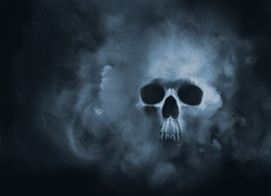 Scary skull emerging from a cloud of smoke / high contrast image