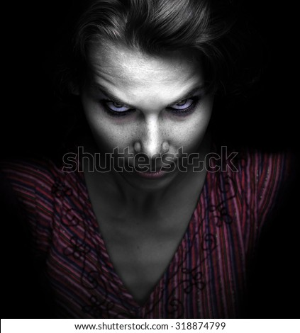 Scary spooky evil woman in the dark