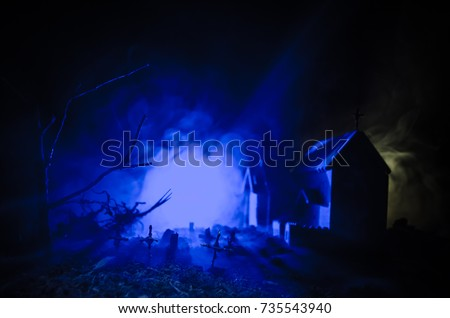 Scary haunted ghost graveyard at night  Halloween concept