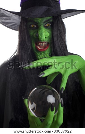 Scary witch with her crystal ball, isolated on white.