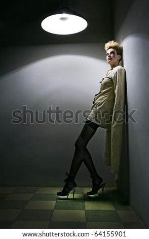 scary zombie girl in gray room in mental hospital