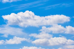 Scattered cloud clusters in a blue sky