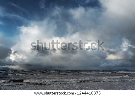 Scattered clouds over Baltic sea.