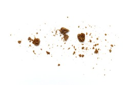 Scattered crumbs of chocolate chip butter cookies on white background.