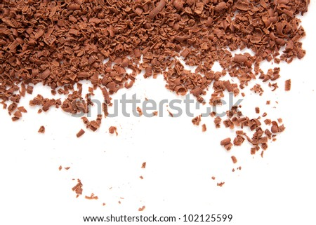Scattered grated dark chocolate.  Isolated on white background #102125599