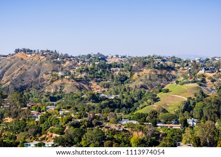 Scattered houses on one of the hills of Bel Air neighborhood, Los Angeles, California Сток-фото ©