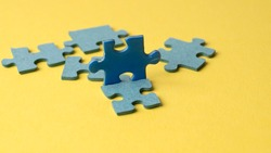 scattered puzzle pieces on colored background