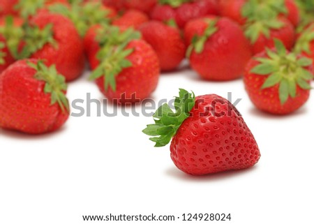 Scattered ripe strawberry isolated on white background