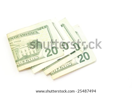 Scattered twenty dollar bills folded and spread out