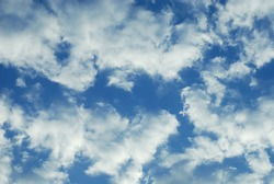 Scattered white cloud in high sky atmosphere. Natural fluffy cloud in light blue sky background sunny day.
