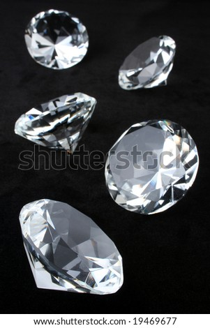 Scattering of round brilliant cut diamonds over black velvet