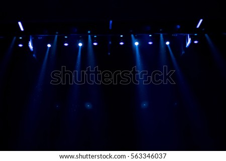 scene, a curtain theater. stage light with colored spotlights. #563346037
