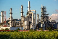 Scene evening of tank oil refinery plant tower and column tank oil of Petrochemistry industry blue sky and lawn