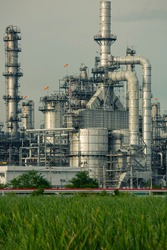 Scene evening of tank oil refinery plant tower and column tank oil of Petrochemistry industry front lawn