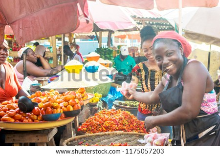 scene from a market with women selling food items like peppers and tomatoes