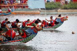 Scene of a competitive boat racing in the Dragon Boat Festival in Taipei, Taiwan, where the athletes pull vigorously on the oars & compete with all their strength in traditional colorful dragon boats