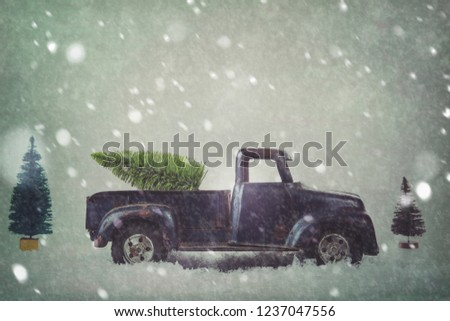 Scene of a generic antique vintage toy truck carrying a bottle brush Christmas tree