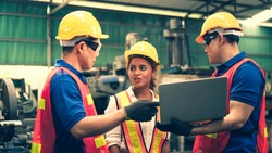 Scene of inspectors team asking information with woman worker and checking the safety and review the function in a factory, concept auditor safety, quality control in a factory, quality inspection.