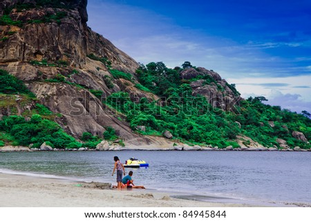 scene of Thai gulf with boy and girl at the beach