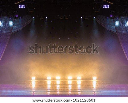scene, stage light with colored spotlights and smoke #1021128601