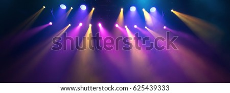 scene, stage light with colored spotlights and smoke #625439333